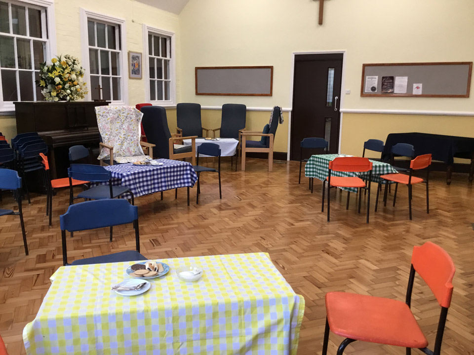 Tables and chairs laid out in cafe style for the church coffee morning